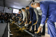 Los Angeles Clippers owner Steve Ballmer along with players Kawhi Leonard and Paul George, head coach Tyronn Lue, Inglewood Mayor James Butts, Jerry West, Gillian Zucker, pose with shovels during a groundbreaking ceremony of the Intuit Dome, Friday, Sept. 17, 2021, in Inglewood, Calif. The Clippers' long-awaited, $1.8 billion, the privately funded arena is officially named Intuit Dome. The practice facility, team offices for both business and basketball operations, retail space, and more will all be on the site when it opens in 2024. (AP Photo/Ringo H.W. Chiu)