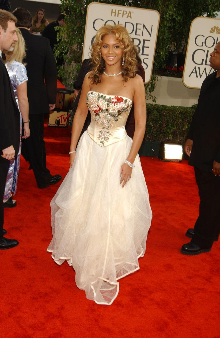 <p>In 2003, Beyoncé walked the carpet in a Les Habitudes gown with embroidered flowers on the bodice.</p>