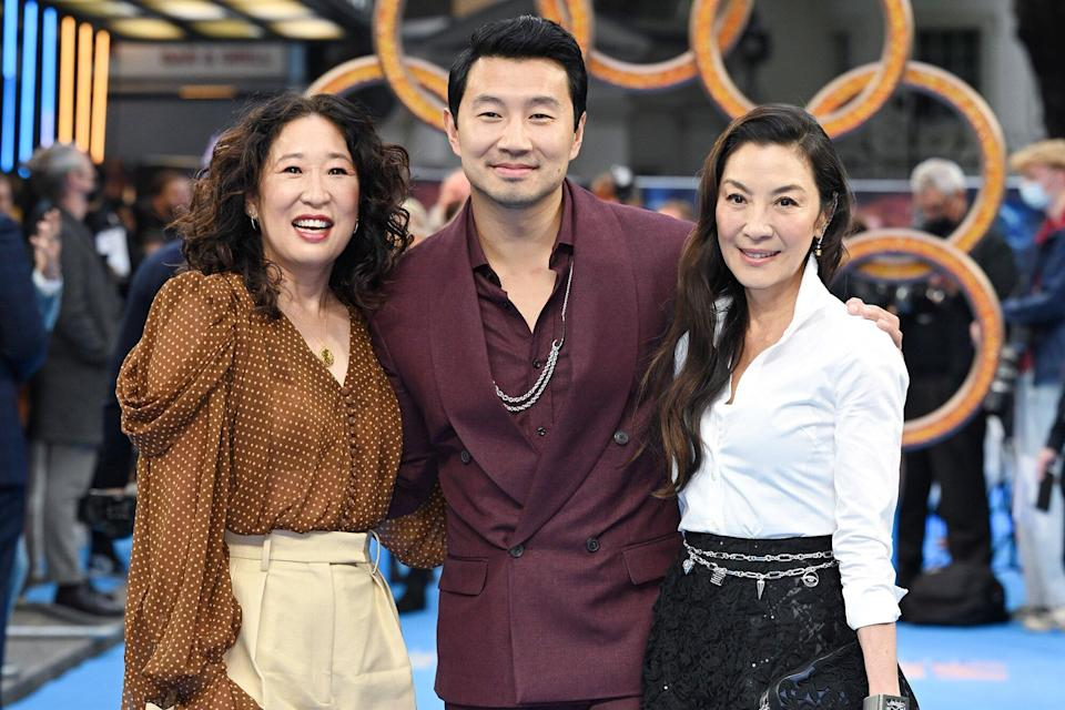 """Simu Liu, Michelle Yeoh and Sandra Oh attend the """"Shang-Chi and the Legend of the Ten Rings"""" UK Gala Screening at Curzon Cinema Mayfair on August 26, 2021 in London, England"""