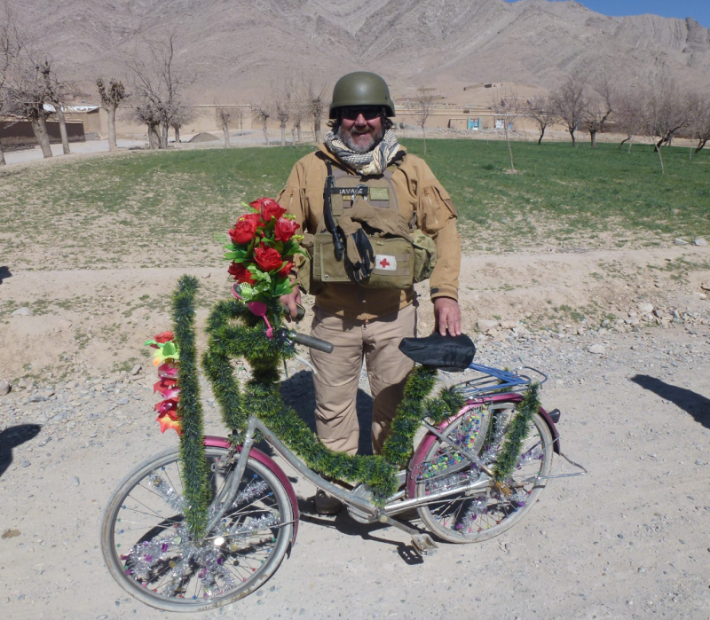 David Savage from Canberra pictured with bicycle in Afghanistan in 2012 where he sustained permanent injuries in a suicide bomb attack.