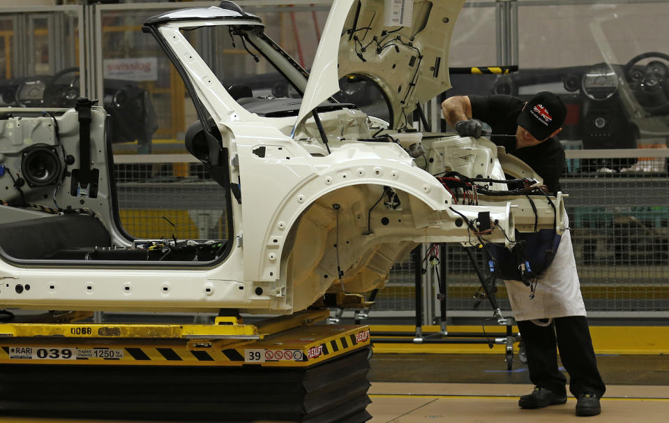 An employee works on a Mini at BMW's plant in Oxford, southern England