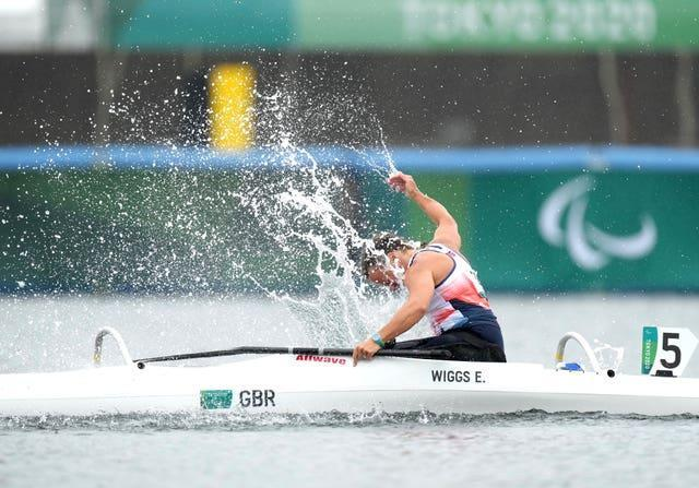 Great Britain's Emma Wiggs punches the water following Paralympic gold in the va'a discipline of paracanoe