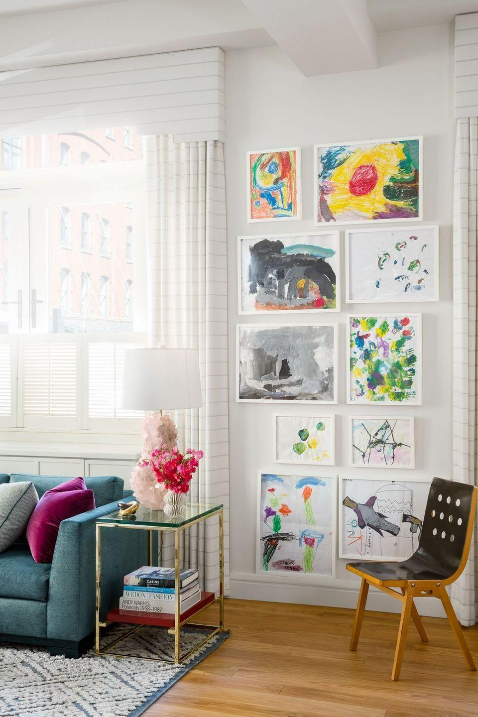 "<p>Frame your children's best masterpieces and display them with pride. They'll feel like a proud artist, and won't have to spend a fortune on art—it's a win-win. It can look refined when professionally done with clean, modern frames and then arranged in a classic floor-to-ceiling grid. Take note from this charming contemporary family room designed by <a href=""http://lillybunn.com/"" rel=""nofollow noopener"" target=""_blank"" data-ylk=""slk:Lilly Bunn"" class=""link rapid-noclick-resp"">Lilly Bunn</a>, where colorful art animates the entire space.</p>"