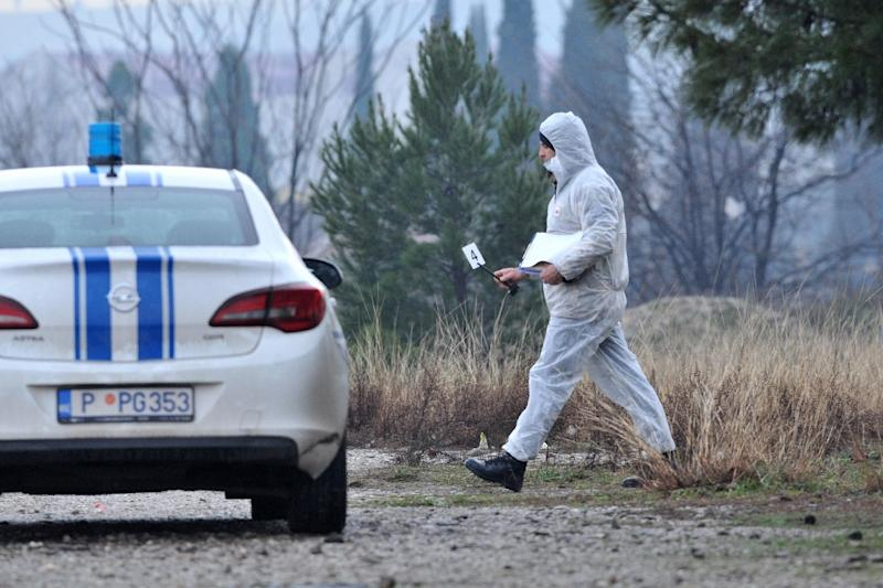 A forensic expert examined the area around the embassy (AFP Photo/SAVO PRELEVIC                       )