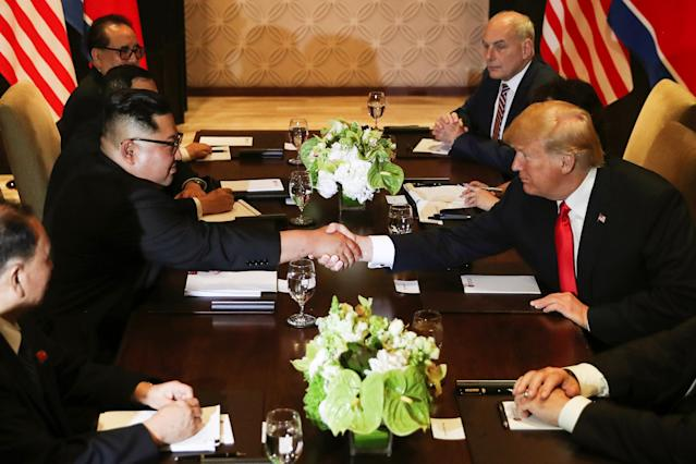 <p>U.S. President Donald Trump shakes hands with North Korea's leader Kim Jong Un before their expanded bilateral meeting at the Capella Hotel on Sentosa island in Singapore June 12, 2018. (Photo: Jonathan Ernst/Reuters) </p>