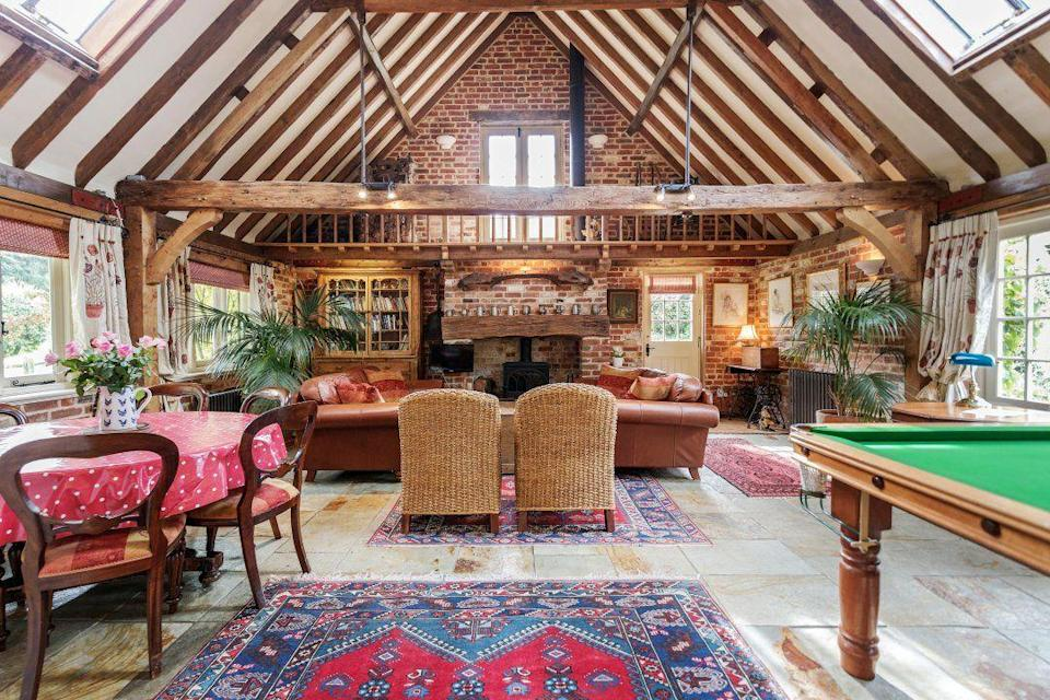 """<p>A traditional barn in the woodlands of the Surrey Hills near the market town of Dorking, where only walkers and horse riders make up the traffic, this is a fabulous home from home outside of London. </p><p>A pool table for entertainment, three bedrooms and beautiful features, like the exposed beams and picturesque garden, make this one place you'll love for a weekend getaway with friends or family.</p><p><a class=""""link rapid-noclick-resp"""" href=""""https://airbnb.pvxt.net/AoyBrj"""" rel=""""nofollow noopener"""" target=""""_blank"""" data-ylk=""""slk:CHECK AVAILABILITY"""">CHECK AVAILABILITY</a></p>"""