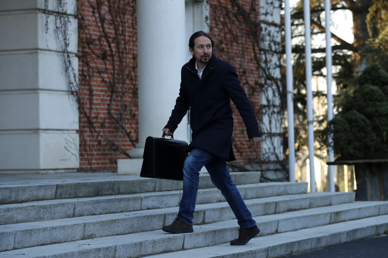 Podemos (United We Can) leader Pablo Iglesias arrives to take part at the first Cabinet meeting at the Moncloa Palace in Madrid, Spain, Tuesday, Jan. 14 2020. Spain's first coalition government in the four decades since the return of democracy took shape Monday as 22 Cabinet ministers took their oaths of office. (AP Photo/Manu Fernandez)