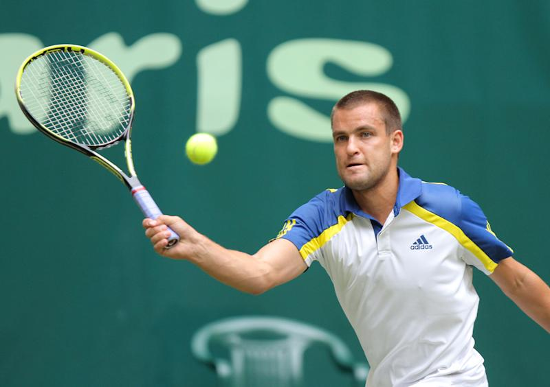 Russian tennis player Mikhail Youzhny returns a ball to German Philipp Kohlschreiber during their quarterfinal match at the Gerry Weber Open ATP tennis tournament in Halle, Germany, Friday June 14, 2013. (AP Photo/dpa,Oliver Krato)