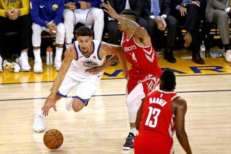 May 26, 2018; Oakland, CA, USA; Golden State Warriors guard Klay Thompson (11) drives to the basket against Houston Rockets guard Gerald Green (14) during the first quarter in game six of the Western conference finals of the 2018 NBA Playoffs at Oracle Arena. Mandatory Credit: Cary Edmondson-USA TODAY Sports