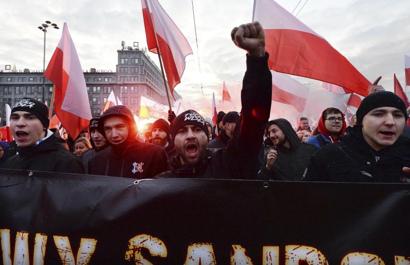 People take part in the March of Independence organized by far right activists to celebrate 101 years of Poland's independence in Warsaw, Poland, Monday, Nov. 11, 2019. (AP Photo/Czarek Sokolowski)