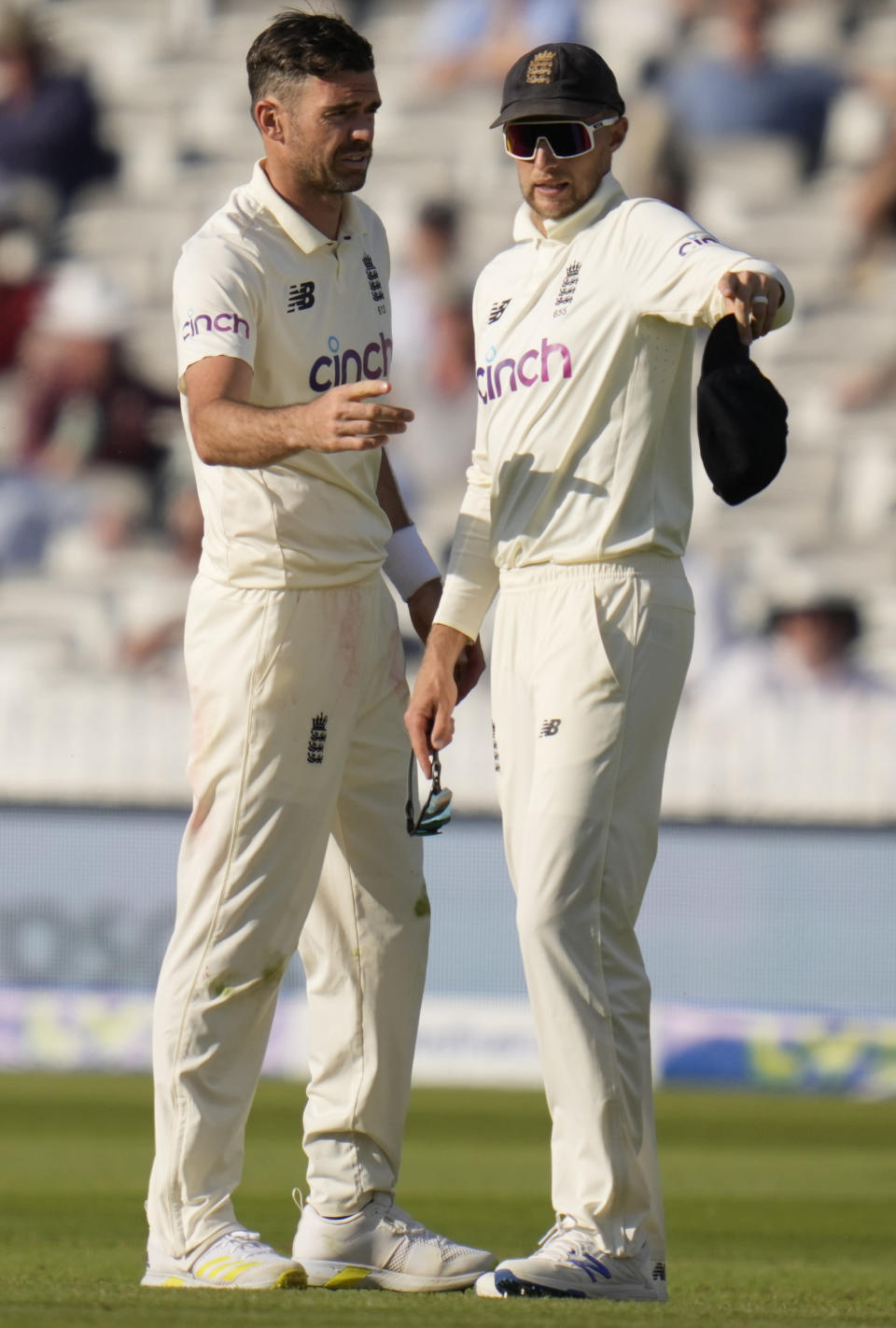 England's Joe Root, right, talks to England's James Anderson during the fourth day of the Test match between England and New Zealand at Lord's cricket ground in London, Saturday, June 5, 2021. (AP Photo/Kirsty Wigglesworth)