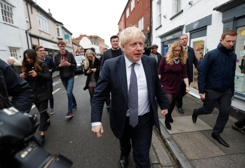 Britain's Prime Minister Boris Johnson walks along the high street during a General Election campaign trail stop in Wells, southwest England on November 14, 2019. (Photo by Frank Augstein / POOL / AFP) (Photo by FRANK AUGSTEIN/POOL/AFP via Getty Images)