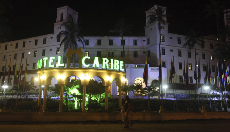 People walk past Hotel El Caribe in Cartagena, Colombia, late Thursday, April 19, 2012. Eleven Secret Service employees are accused of misconduct in connection with a prostitution scandal at the hotel last week before President Barack Obama's arrival for the Summit of the Americas. The identities of two Secret Service supervisors who have been pushed out of the agency in the wake of the scandal have been revealed. (AP Photo/Pedro Mendoza)