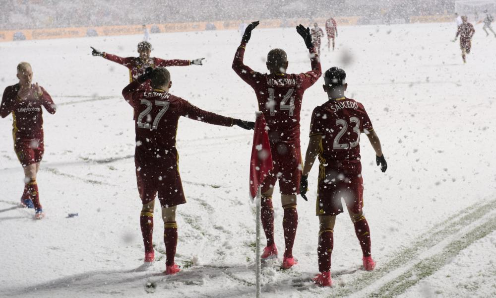 Real Salt Lake celebrate a goal while trying to keep warm against the Vancouver Whitecaps
