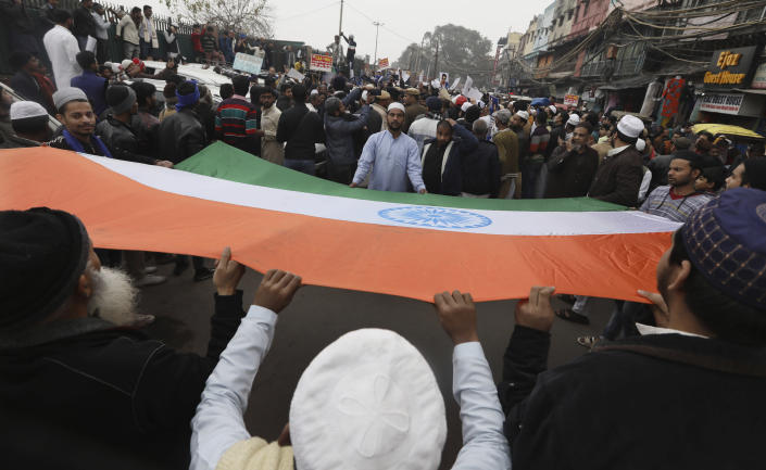 Indian Muslims carry a national flag during a protest against a new Citizenship law, after Friday prayers in New Delhi, India, Friday, Jan. 17, 2020. Protests against India's citizenship law that excludes Muslim immigrants continue in Indian cities in an unabating strong show of dissent against the Hindu nationalist government of Prime Minister Narendra Modi. (AP Photo/Manish Swarup)