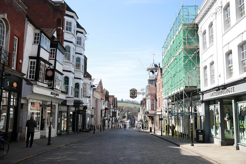 Embargoed to 0001 Friday April 03 File photo dated 24/3/2020 of an empty high-street in Guildford the day after Prime Minister Boris Johnson put the UK in lockdown to help curb the spread of the coronavirus. Britain's high street retailers suffered their worst month on record in March as they were hammered by the Covid-19 lockdown, according to new figures.