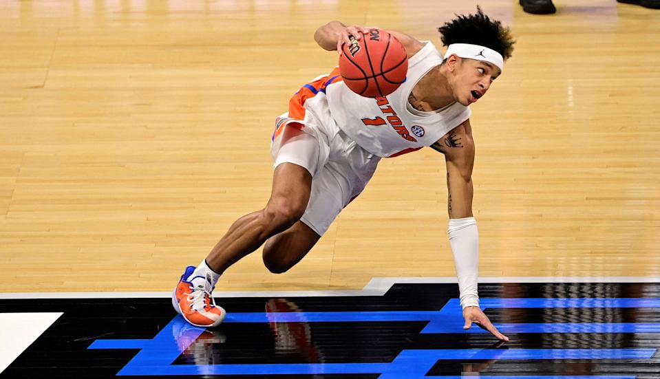 Mar 19, 2021; Indianapolis, Indiana, USA; Florida Gators guard Tre Mann (1) controls the ball against the Virginia Tech Hokies during the first round of the 2021 NCAA Tournament at Hinkle Fieldhouse. Mandatory Credit: Marc Lebryk-USA TODAY Sports ORG XMIT: IMAGN-450055 ORIG FILE ID:  20210319_jla_lb1_034.jpg