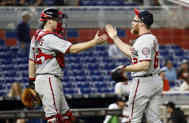 Washington Nationals relief pitcher Sean Doolittle, right, and catcher Matt Wieters congratulate each other after the Nationals defeated the Miami Marlins 4-2 in a baseball game, Tuesday, Sept. 18, 2018, in Miami. (AP Photo/Wilfredo Lee)