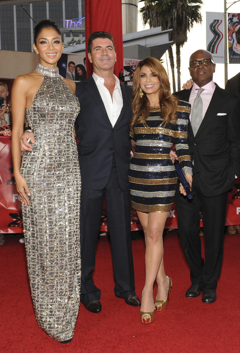 "FILE-   In this Wednesday, Sept. 14, 2011 file image released by Fox, judges, from left, Nicole Sherzinger, Simon Cowell, Paula Abdul, and L.A. Reid attend ""The X Factor"" screening at the Arclight Cinerama Dome in Los Angeles.   (AP Photo/FOX, Frank Micelotta, FILE)"