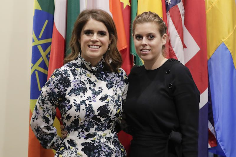 Princess Eugenie and her Sister Princess Beatrice of York posing in front of the flags of several nations at the United Nations in New York City, New York, July 26, 2018. (Photo by EuropaNewswire/Gado/Getty Images)