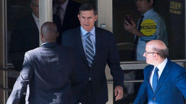 PHOTO: Gen. Michael Flynn, center, with his attorney, Robert Kelner, right, leaves Federal Court in Washington, DC, December 1, 2017 after pleading guilty to one count of lying to the FBI about his back-channel negotiations with the Russian ambassador. (Saul Loeb/AFP/Getty Images)