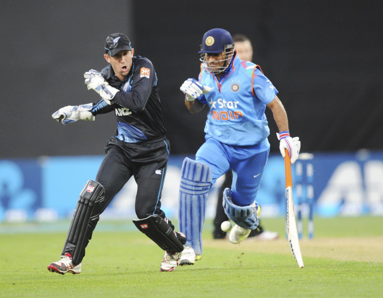 New Zealand's Luke Ronchi, left, and India's MS Dhoni bump eachother during the fifth one day International cricket match at Westpac Stadium in Wellington, New Zealand, Friday, Jan. 31, 2014. (AP Photo/SNPA, Ross Setford) NEW ZEALAND OUT