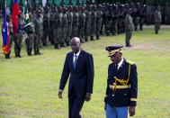 Haiti's President Jovenel Moise, left, reviews troops with Jodel Lesage, lieutenant-general of the Armed Forces, at the national palace during a ceremony marking the 216th anniversary of Battle of Vertieres in Port-au-Prince, Haiti, Monday, Nov. 18, 2019. The battle was the last major battle of Haitian independence from France. (AP Photo/Dieu Nalio Chery)