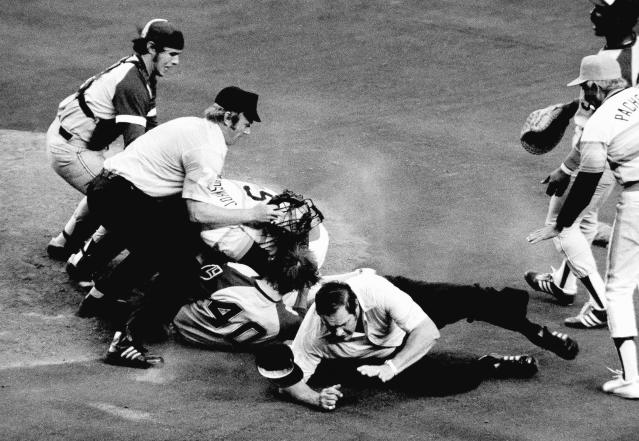 FILE - In this April 1977 file photo, umpires Paul Runge, left, and Lee Weyer, on ground, try to break up a fight between Atlanta Braves pitcher Dick Ruthven (40), who hit Houston Astros' Cliff Johnson (6) with a pitch in the sixth inning of a baseball game in Houston. Braves catcher Biff Pocoroba is at left. No one was injured in the melee but Johnson was ejected. Pocoroba, who played in the 1978 All-Star Game and was a backup on the Braves team that won an improbable NL West title in 1982, has died at age 66. Tom Wages Funeral Services in Snellville, Ga., confirmed that Pocoroba died Sunday, May 24, 2020. No cause of death was given. (AP Photo, File)