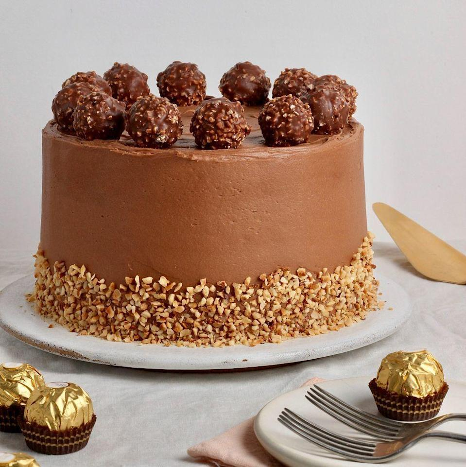 """<p>This Ferrero Rocher <a href=""""https://www.delish.com/uk/cooking/recipes/g31954424/easter-cake-recipes/"""" rel=""""nofollow noopener"""" target=""""_blank"""" data-ylk=""""slk:cake"""" class=""""link rapid-noclick-resp"""">cake</a> is a seriously indulgent bake with a soft, hazelnut spiked sponge coated in a delicious <a href=""""https://www.delish.com/uk/cooking/recipes/a35582220/nutella-cups-recipe/"""" rel=""""nofollow noopener"""" target=""""_blank"""" data-ylk=""""slk:Nutella"""" class=""""link rapid-noclick-resp"""">Nutella</a> frosting, topped with everyone's favourite chocolate treats. This would be perfect for a decadent <a href=""""https://www.delish.com/uk/cooking/recipes/a34726279/birthday-cake-banana-bread-recipe/"""" rel=""""nofollow noopener"""" target=""""_blank"""" data-ylk=""""slk:birthday cake"""" class=""""link rapid-noclick-resp"""">birthday cake</a> - or just a treat for yourself!</p><p>Get the <a href=""""https://www.delish.com/uk/cooking/recipes/a35901680/fererro-rocher-cake/"""" rel=""""nofollow noopener"""" target=""""_blank"""" data-ylk=""""slk:Fererro Rocher Cake"""" class=""""link rapid-noclick-resp"""">Fererro Rocher Cake</a> recipe. </p>"""