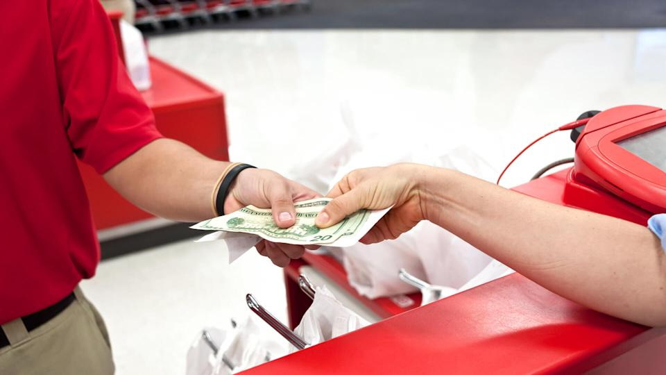 Woman receiving cash back with receipt at a department store