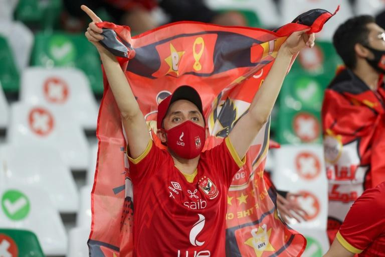 An Al-Ahly fan cheers on their side at their first FIFA Club World Cup clash against Qatar's Al-Duhail