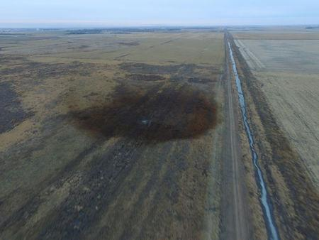 An aerial view shows the darkened ground of an oil spill which shut down the Keystone pipeline between Canada and the United States, located in an agricultural area near Amherst, South Dakota, U.S., in this photo provided November 18, 2017.    REUTERS/Dronebase