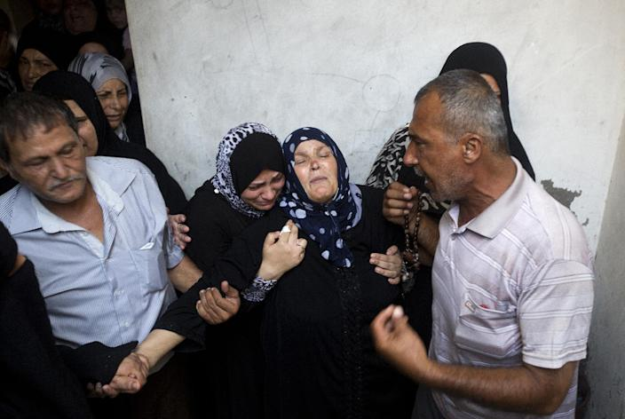The mother (centre) of Palestinian Mahmud Abbas, who was killed by an Israeli air strike, mourns during his funeral in Gaza City on August 24, 2014 (AFP Photo/Mahmud Hams)