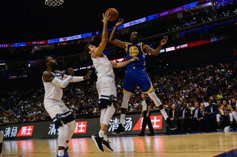 Golden State's Kevin Durant (R) in action against the Minnesota Timberwolves in Shanghai 2017. The NBA is hugely popular in China with teams like the Golden State Warriors having millions of followers (AFP Photo/CHANDAN KHANNA)
