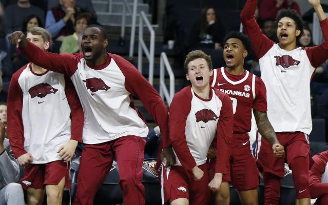 The Arkansas bench reacts during the second half of a first round NCAA National Invitation Tournament college basketball game against Providence in Providence, R.I., Tuesday, March 19, 2019. (AP Photo/Michael Dwyer)
