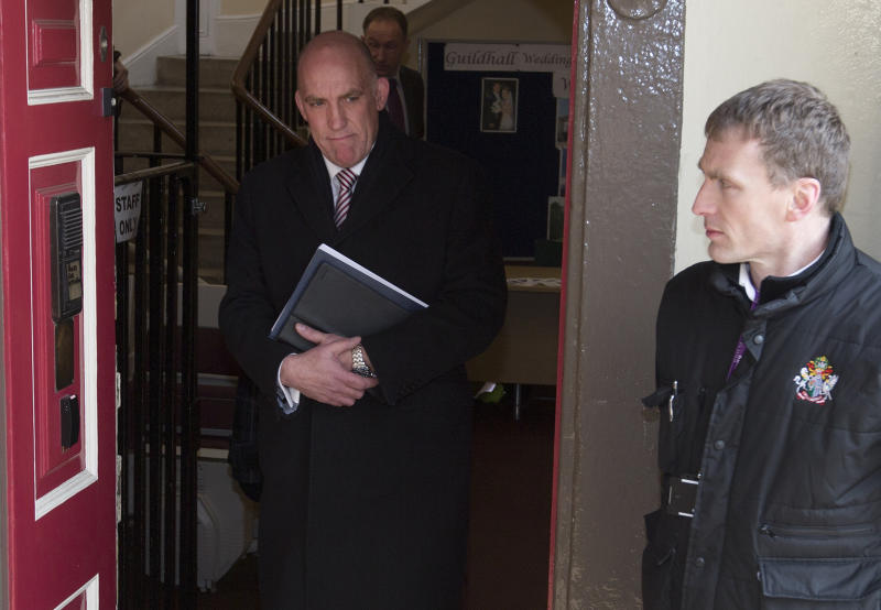 Detective inspector Mark Bissell of Thames Valley police leaves the inquest into the death of Russian oligarch Boris Berezovsky after giving evidence to the coroner in Windsor, England Thursday, March, 28, 2013. Berezovsky was found dead at his home in Ascot near Windsor on Saturday March 23.(AP Photo/Alastair Grant)