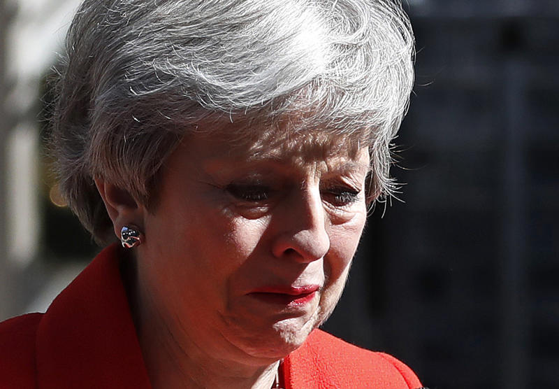 British Prime Minister Theresa May reacts as she turns away after making a speech in the street outside 10 Downing Street in London, England, Friday, May 24, 2019. Theresa May says she'll quit as UK Conservative leader on June 7, sparking contest for Britain's next prime minister. (AP Photo/Alastair Grant)