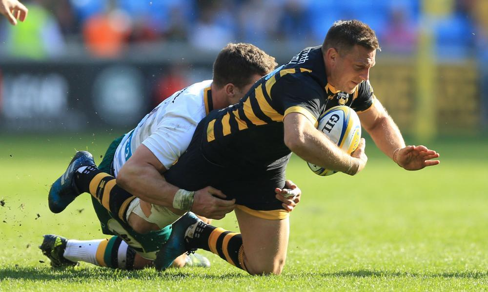 Jimmy Gopperth, who scored Wasps' winning conversion in the last minute, is tackled by Northampton's George North.