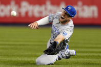 Kansas City Royals left fielder Hunter Dozier (17) dives for a ball hit by New York Yankees Gio Urshela (29) but comes up short during the ninth inning of a baseball game, Tuesday, June 22, 2021, at Yankee Stadium in New York. The Royals defeated the Yankees 6-5. (AP Photo/Kathy Willens)