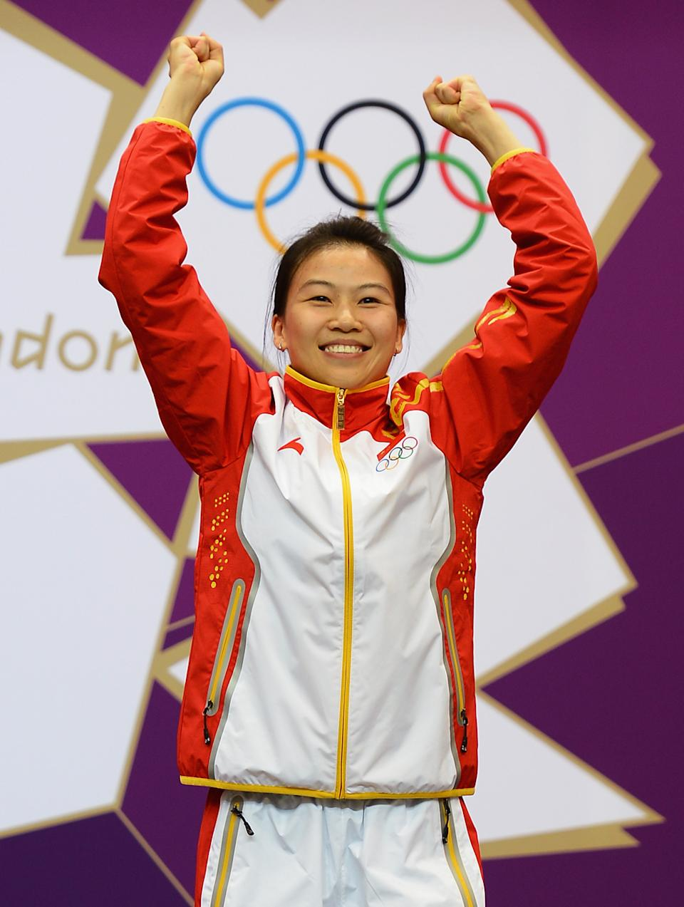 Siling Yi of China celebrates winning the first gold medal of the London Games. She won the Women's 10m Air Rifle Shooting Final on Day 1 of the London 2012 Olympic Games at The Royal Artillery Barracks on July 28, 2012 in London, England. Sylwia Bogacka of Poland won silver and Dan Yu of China won bronze. (Photo by Lars Baron/Getty Images)