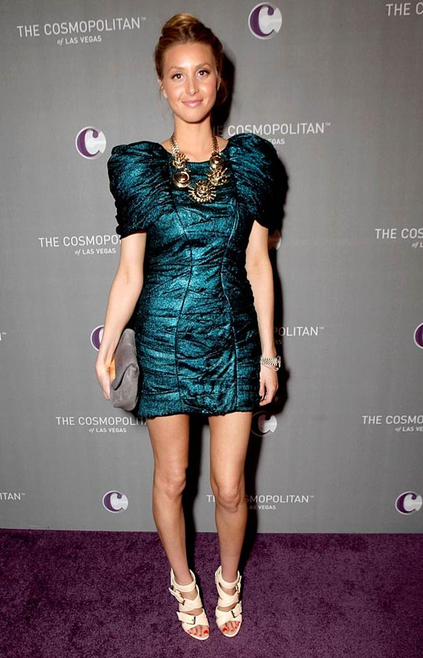 "Meanwhile, at Marquee nightclub in Sin City's swanky new Cosmopolitan hotel, former ""City"" star Whitney Port arrived for the Jay-Z/Coldplay New Year's Eve concert in a fashion-forward Jill Stuart frock, statement necklace, and strappy stilettos. Todd Williamson/<a href=""http://www.wireimage.com"" target=""new"">WireImage.com</a> - December 31, 2010"