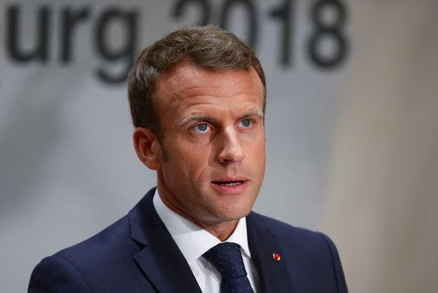 President Emmanuel Macron holds a news conference after the informal meeting of European Union leaders in Salzburg, Austria