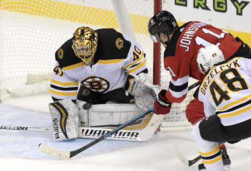 Boston Bruins goaltender Tuukka Rask (40) stops a shot by New Jersey Devils left wing Andreas Johnsson (11) during the second period of an NHL hockey game Thursday, Jan. 14, 2021, in Newark, N.J. (AP Photo/Bill Kostroun)