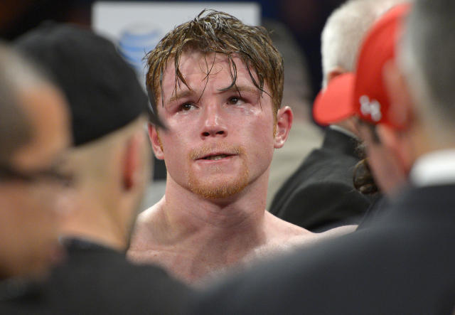 Canelo Alvarez reacts after losing to Floyd Mayweather Jr. during a 152-pound title fight, Saturday, Sept. 14, 2013, in Las Vegas. (AP Photo/Mark J. Terrill)