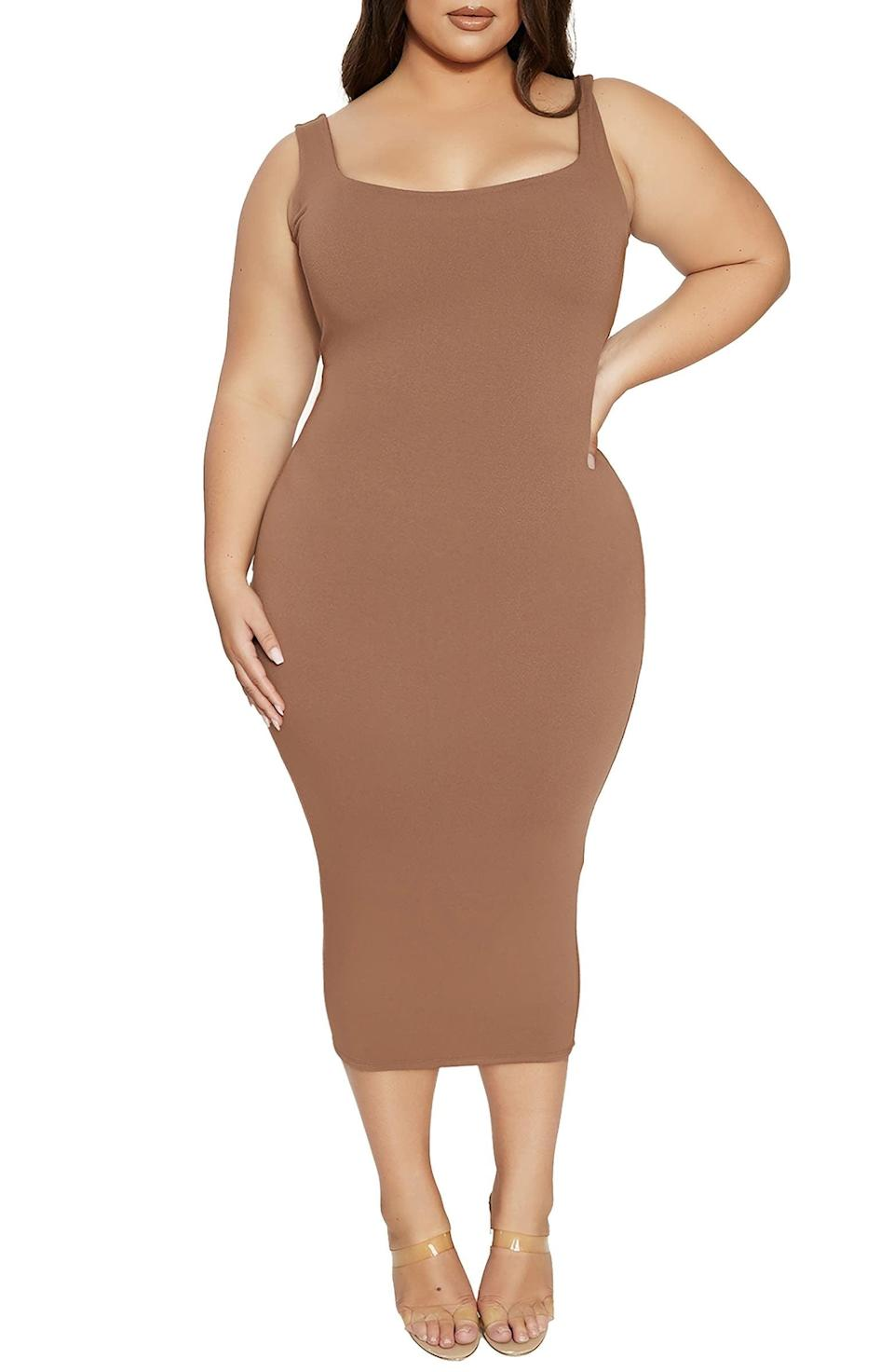 <p>Show off your curves with pride in this <span>Naked Wardrobe Hourglass Midi Dress</span> ($64). It's designed to hug your body in a flattering and elevated way.</p>