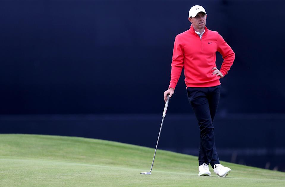 Rory McIlroy leans on his putter (PA Wire)