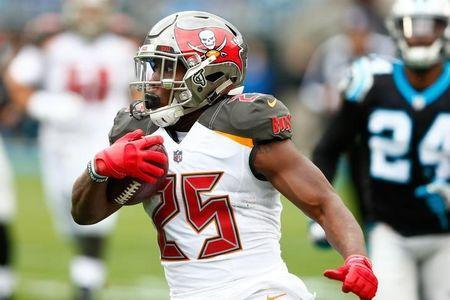 FILE PHOTO: Dec 24, 2017; Charlotte, NC, USA; Tampa Bay Buccaneers running back Peyton Barber (25) runs the ball in the first quarter against the Carolina Panthers at Bank of America Stadium. Mandatory Credit: Jeremy Brevard-USA TODAY Sports