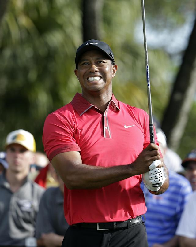 Tiger Woods watches his tee shot on the 12th hole during the final round of the Cadillac Championship golf tournament Sunday, March 9, 2014, in Doral, Fla. (AP Photo/Lynne Sladky)
