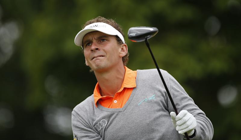 Luiten masters weather to take KLM Open lead