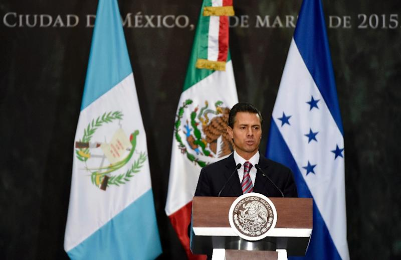Mexican President Enrique Pena Nieto delivers a speech in Mexico City on March 13, 2015 (AFP Photo/Alfredo Estrella)